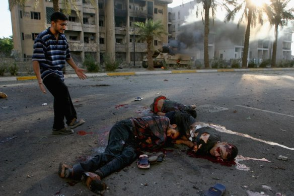 dead-and-injured-iraqi-civilians-on-haifa-street-baghdad-after-a-us-helicopter-attack-photo-ghaith-abdul-ahadgetty-images